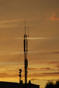 sunset over radio tower